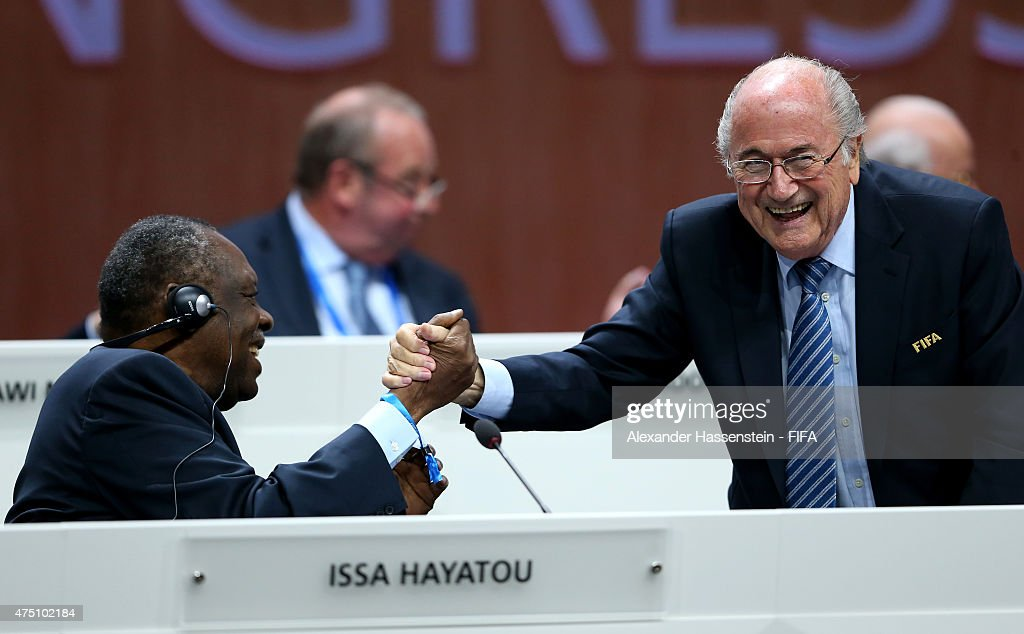 President Joseph S Blatter shakes hands with FIFA Senior Vice President Issa Hayatou of Cameroon during the 65th FIFA Congress at the Hallenstadion...