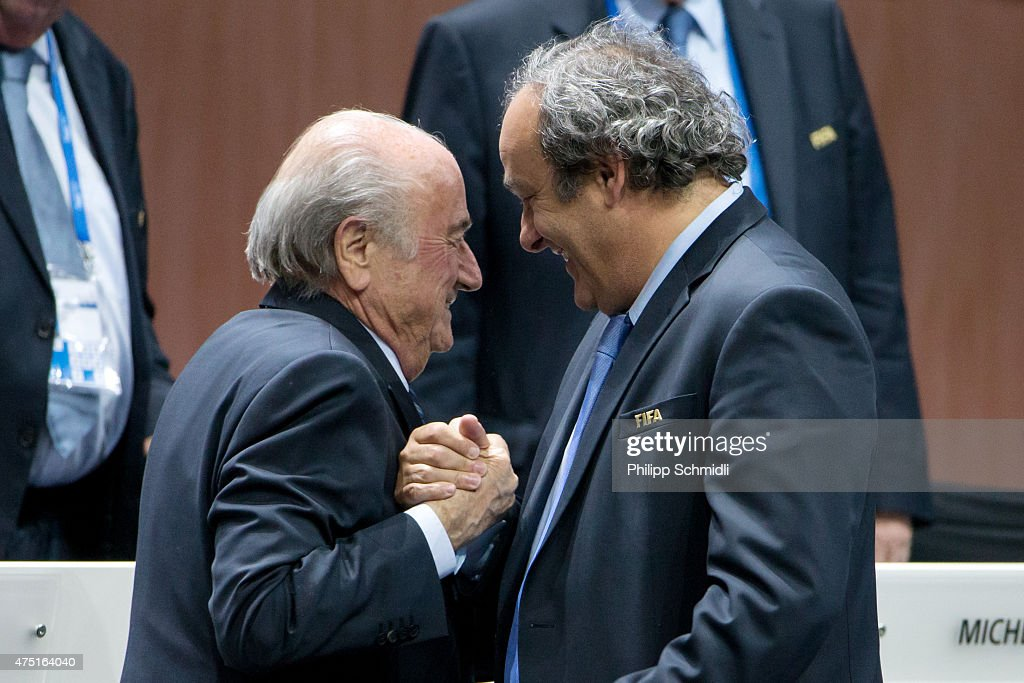 President Joseph S. Blatter (L) shakes hands with UEFA president Michel Platini during the 65th FIFA Congress at Hallenstadion on May 29, 2015 in Zurich, Switzerland.