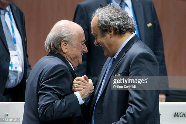 President Joseph S Blatter shakes hands with UEFA president Michel Platini during the 65th FIFA Congress at Hallenstadion on May 29 2015 in Zurich...