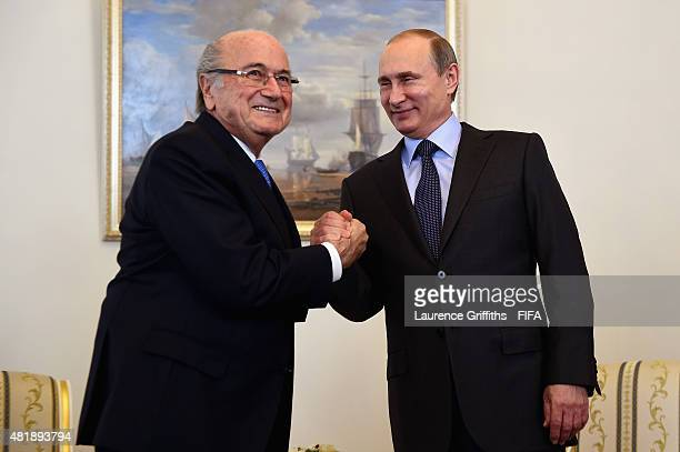 President Joseph S Blatter shakes hands with Vladimir Putin President of Russia ahead of the Preliminary Draw of the 2018 FIFA World Cup in Russia at...
