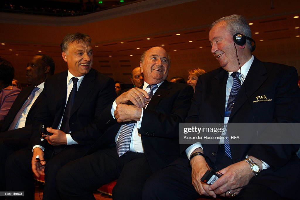 President Joseph S. Blatter (C) smiles with Hungarian Prime Minister <a gi-track='captionPersonalityLinkClicked' href=/galleries/search?phrase=Viktor+Orban&family=editorial&specificpeople=4685765 ng-click='$event.stopPropagation()'>Viktor Orban</a> (L) and FIFA vice president <a gi-track='captionPersonalityLinkClicked' href=/galleries/search?phrase=Julio+Grondona+-+Executivo+de+futebol&family=editorial&specificpeople=13441821 ng-click='$event.stopPropagation()'>Julio Grondona</a> (R)prior the Opening Ceremony for the 62nd FIFA Congress at Budapest Congress Center on May 24, 2012 in Budapest, Hungary.