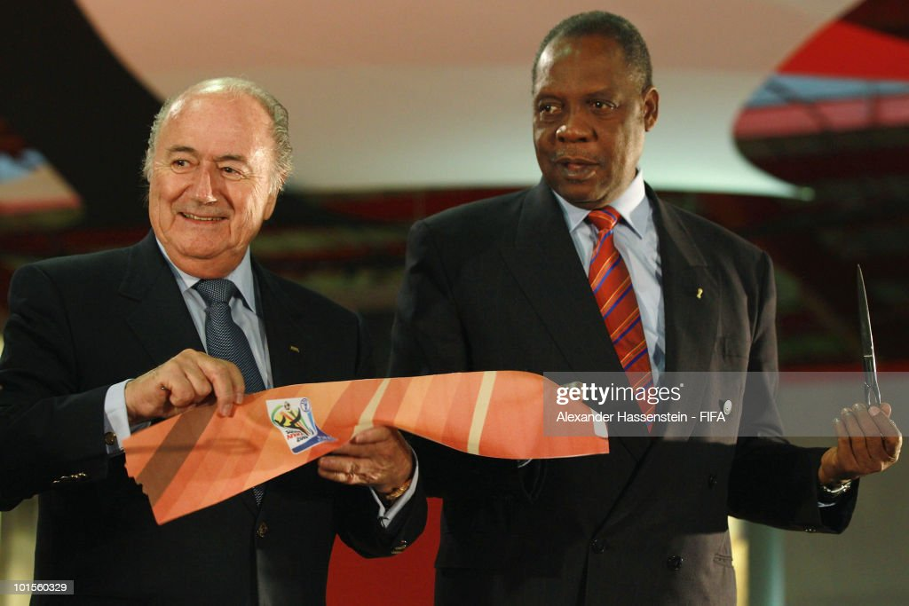 FIFA president Joseph S Blatter smiles with Issa Hayatou CAF President and Chairman of the FIFA World Cup 2010 Organising Committee after the ribbon...