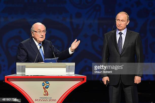 President Joseph S Blatter speaks as Vladimir Putin President of Russia looks on during the Preliminary Draw of the 2018 FIFA World Cup in Russia at...