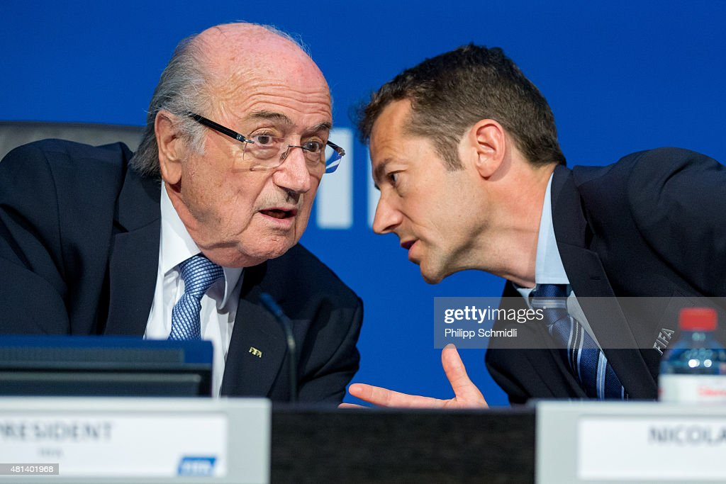 President Joseph S. Blatter (L) speaks with FIFA Director of Communications Nicolas Maingot during a press conference at the Extraordinary FIFA Executive Committee Meeting at the FIFA headquarters on July 20, 2015 in Zurich, Switzerland.