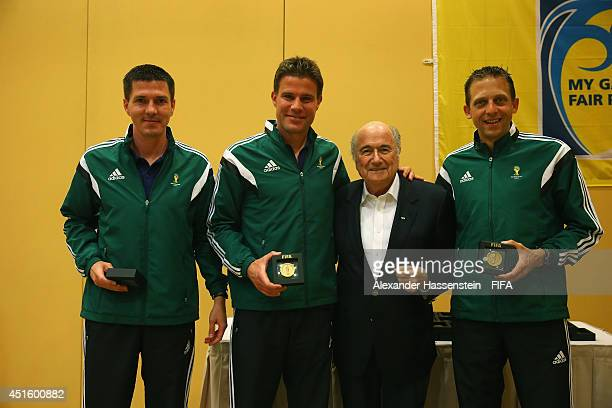 President Joseph S Blatter talks to 2014 FIFA World Cup Referee Felix Brych of Germany and his assistens Stefan Lupp and Mark Borsch at the 2014 FIFA...
