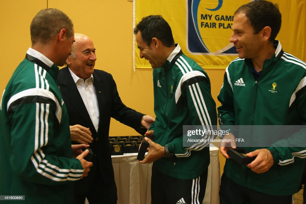 President Joseph S. Blatter talks to Carlos Velasco Carbello (2nd L) of Spain and his assistens Roberto Alonso Fernandez (R) and Juan Carlos Yuste Jimenez at the 2014 FIFA World Cup Referees Head Quater Windsor Barra Hotel on July 2, 2014 in Rio de Janeiro, Brazil.