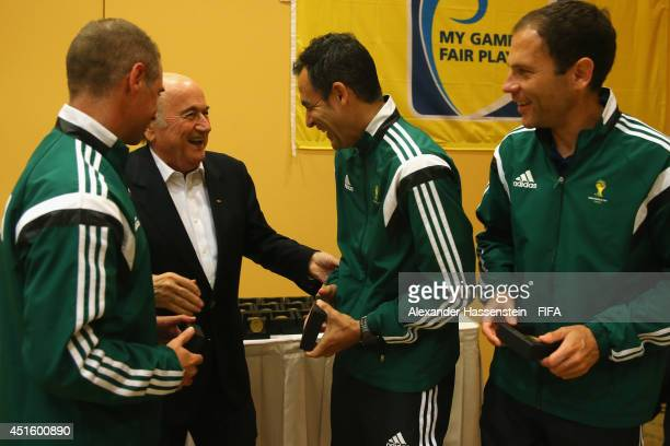 President Joseph S Blatter talks to Carlos Velasco Carbello of Spain and his assistens Roberto Alonso Fernandez and Juan Carlos Yuste Jimenez at the...