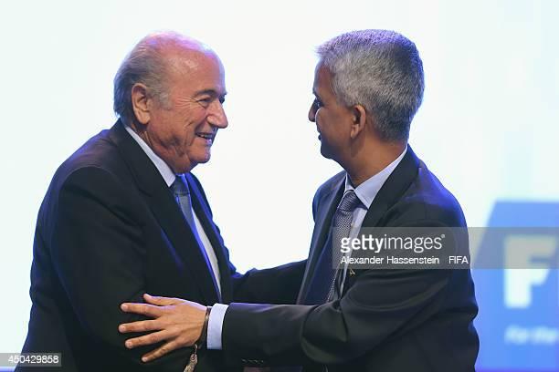 President Joseph S Blatter talks to FIFA Executive member Sunil Gulati prior to the 64th FIFA Congress at TEC on June 11 2014 in Sao Paulo Brazil