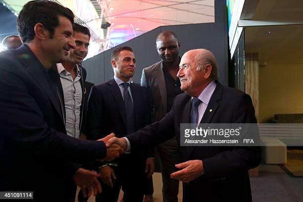 FIFA president Joseph S Blatter talks to Luis Figo Fernando Hierro Fabio Cannavaro and Patrick Vieira during to the 2014 FIFA World Cup Brazil Group...