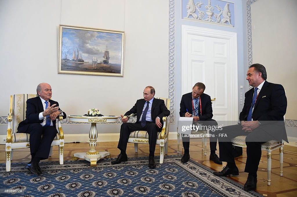 President Joseph S. Blatter, <a gi-track='captionPersonalityLinkClicked' href=/galleries/search?phrase=Vladimir+Putin&family=editorial&specificpeople=154896 ng-click='$event.stopPropagation()'>Vladimir Putin</a>, President of Russia and <a gi-track='captionPersonalityLinkClicked' href=/galleries/search?phrase=Vitaly+Mutko&family=editorial&specificpeople=687552 ng-click='$event.stopPropagation()'>Vitaly Mutko</a> Chairman of the Local Organising Committee speak ahead of the Preliminary Draw of the 2018 FIFA World Cup in Russia at The Konstantin Palace on July 25, 2015 in Saint Petersburg, Russia.