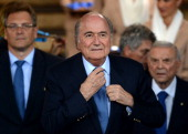 President Joseph S Blatter walks in the tunnel to attend the medal ceremony after the 2014 FIFA World Cup Brazil 3rd Place Playoff match between...