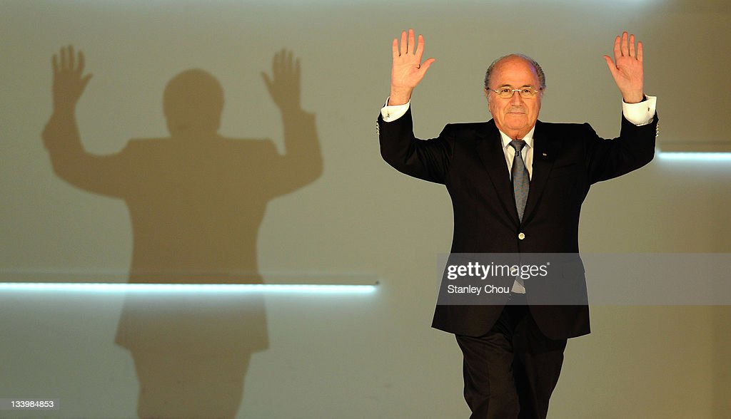 President Joseph S. Blatter waves to the audience as he enters the stage during the 2011 AFC Annual Awards at The Mandrin Oriental Hotel on November 23, 2011 in Kuala Lumpur, Malaysia.