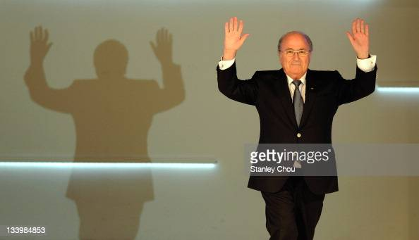 President Joseph S Blatter waves to the audience as he enters the stage during the 2011 AFC Annual Awards at The Mandrin Oriental Hotel on November...