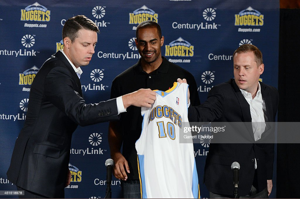 President <a gi-track='captionPersonalityLinkClicked' href=/galleries/search?phrase=Josh+Kroenke&family=editorial&specificpeople=3079825 ng-click='$event.stopPropagation()'>Josh Kroenke</a>, <a gi-track='captionPersonalityLinkClicked' href=/galleries/search?phrase=Arron+Afflalo&family=editorial&specificpeople=640861 ng-click='$event.stopPropagation()'>Arron Afflalo</a> #10 and General Manager <a gi-track='captionPersonalityLinkClicked' href=/galleries/search?phrase=Tim+Connelly&family=editorial&specificpeople=4246885 ng-click='$event.stopPropagation()'>Tim Connelly</a> of the Denver Nuggets during a press conference to announce the return of <a gi-track='captionPersonalityLinkClicked' href=/galleries/search?phrase=Arron+Afflalo&family=editorial&specificpeople=640861 ng-click='$event.stopPropagation()'>Arron Afflalo</a> to the Nuggets on June 30, 2014 at the Pepsi Center in Denver, Colorado.