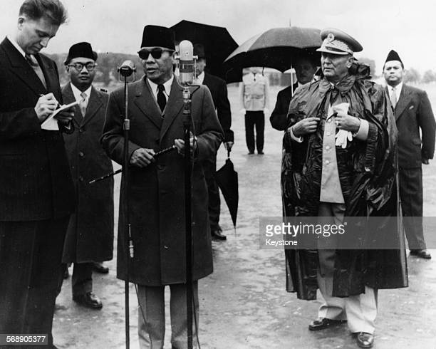 President Josip Broz Tito of Yugoslavia watching as President Sukarno of Indonesia giving a speech as he arrives in Zemin September 14th 1956