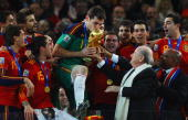 President Jospeph Sepp Blatter and South Africa President Jacob Zuma present the World Cup trophy to Iker Casillas captain of Spain following the...
