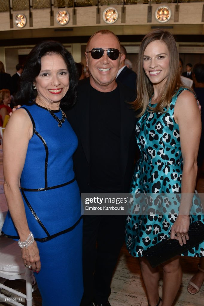 FIT President Joyce F. Brown, designer Michael Kors, and actress Hilary Swank attend The Couture Council of The Museum at the Fashion Institute of Technology hosted luncheon honoring Michael Kors with the 2013 Couture Council Award on September 4, 2013 in New York City.