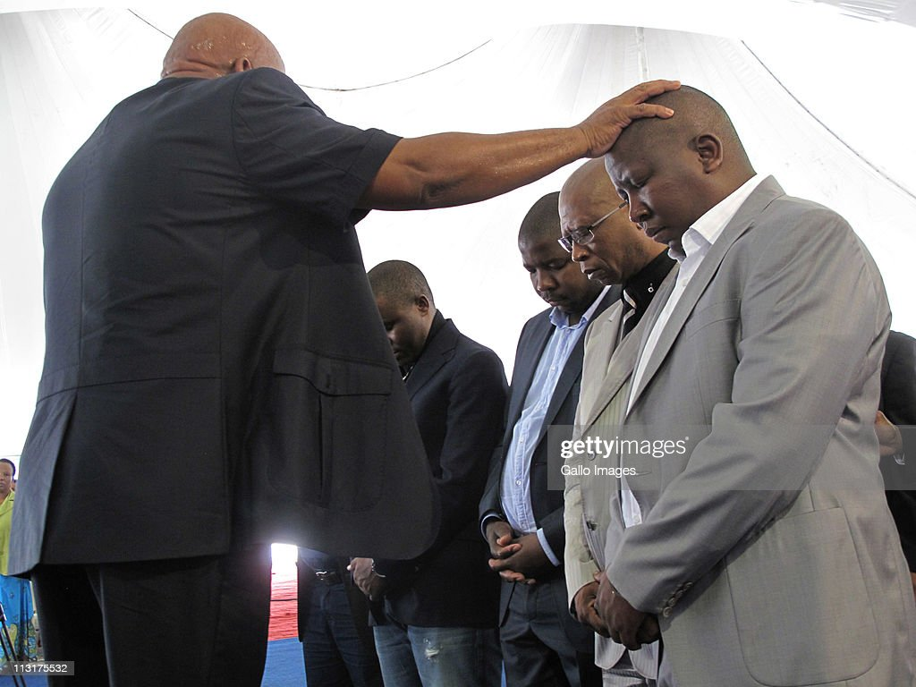 ANCYL president <a gi-track='captionPersonalityLinkClicked' href=/galleries/search?phrase=Julius+Malema&family=editorial&specificpeople=5866727 ng-click='$event.stopPropagation()'>Julius Malema</a> (R) is blessed by Pastor Clement Koma at the Potters House Christian Church on 25 April 25, 2011 in Polokwane, South Africa. Alongside Malema is mayor of Capricorn municipality Lawrence Mapoulo, ANCYL secretary in Limpopo Jacob Lebogo and head of the Limpopo local government and housing Clifford Motsepe. Malema has recently been appearing on trial at Johannesburg High Court on charges of inciting hatred for singing the song 'Shoot The Boer', laid against him by Tshwane-based lobby group AfriForum.