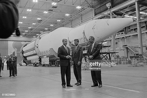 President Kennedy and Vice President Johnson listen as Dr Wernher von Braun director of the George Marshall Space Flight Center here explains...