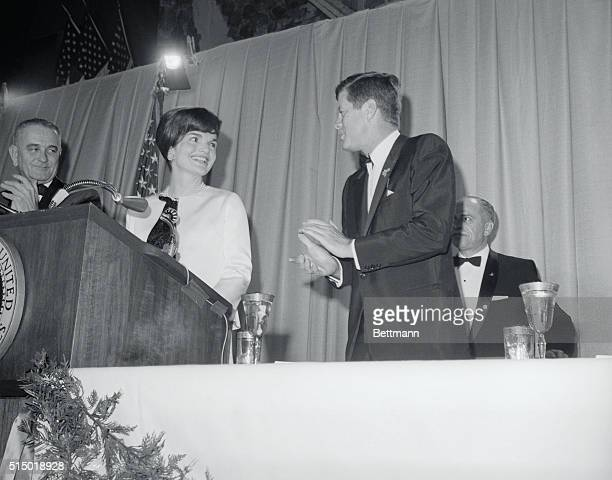 President Kennedy applauds his wife Jacqueline as she is introduced at a nationwide closed circuit tv show 'An American Pageant of Arts' at the...