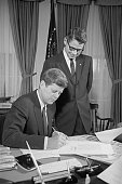 President Kennedy signs the Emergency Feed Grain Bill giving aid to corn and grain farmers