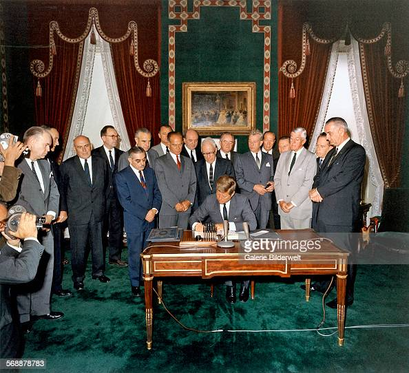 President Kennedy signs the Limited Nuclear Test Ban Treaty in the Treaty Room at the White House 7th October 1963 Left to Right William Hopkins...