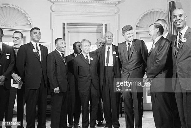 President Kennedy stands with prominent civil rights and labor leaders including Martin Luther King Whitney Young and Walter Reuther