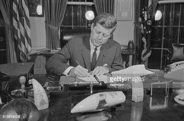 President Kennedy tonight signs a proclamation formally putting into effect at 10 AM EDT tomorrow the US Arms Quarantine against Cuba The President...