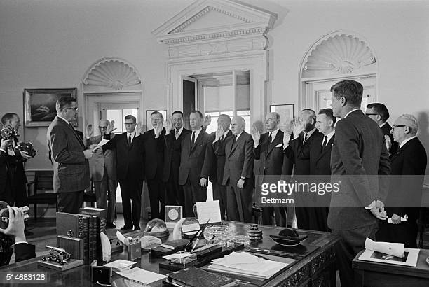 President Kennedy watches as Herbert Miller administers the oath to the members of the General Advisory Committee of the Arms Control and Disarmament...