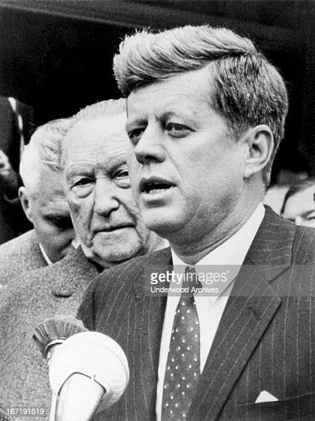 President Kennedy with West German Chancellor Konrad Adenauer declares that they have renewed their pledge to 'preserve the freedom of the people of...
