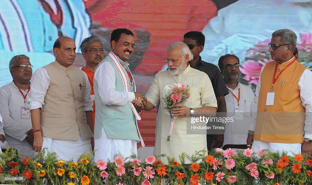 President Keshav Prasad Maurya greets Prime Minister Narendra Modi at a rally to mark the second anniversary of the formation of his government at the centre, on May 26, 2016 in Saharanpur, India. Prime Minister Narendra Modi's speech to mark two years of his government focused on farmers and the poor at a massive rally in Saharanpur in Uttar Pradesh, where crucial assembly elections will be held early next year.