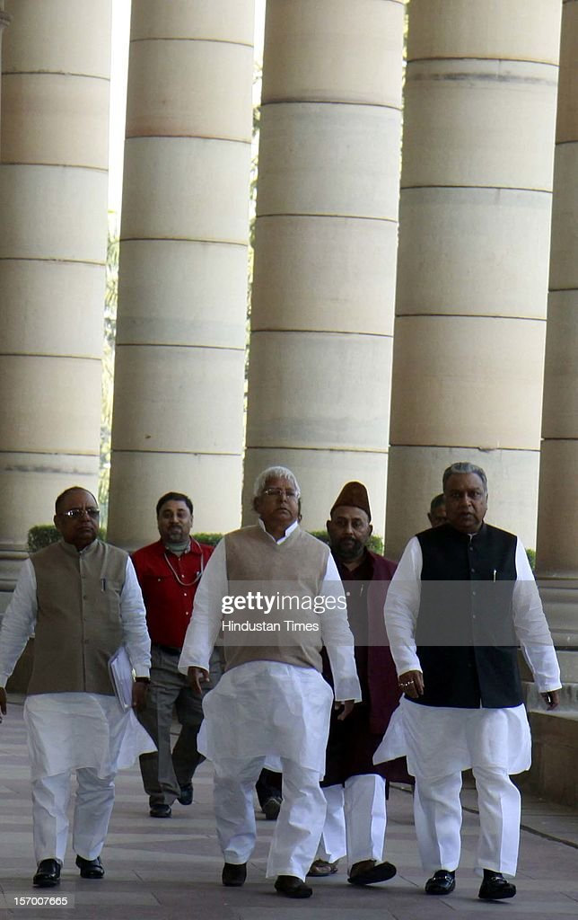 RJD President Lalu Prasad and other party leaders arrive attending all party meeting on to break the deadlock on Foreign Direct Investment issue during the Parliament winter session on November 26, 2012 in New Delhi, India. Main opposition party BJP wants debate under rule 184 which has provision of vote but government wants the speaker to decide on debate rules.