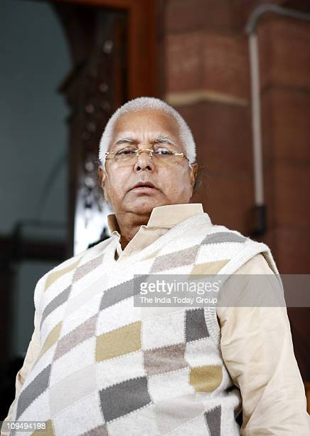 RJD president Lalu Prasad Yadav arrives to attend the budget session of Parliament on Friday February 25 2011