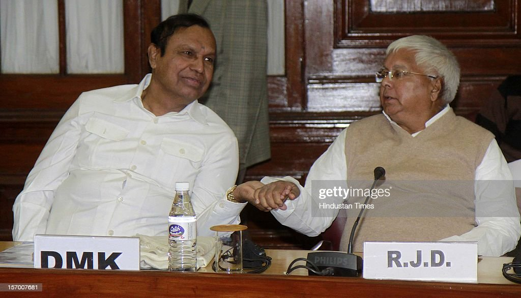 RJD President Lalu Prasad Yadav talking with DMK Leader TR Balu attending all party meeting on to break the deadlock on Foreign Direct Investment issue during the Parliament winter session on November 26, 2012 in New Delhi, India. Main opposition party BJP wants debate under rule 184 which has provision of vote but government wants the speaker to decide on debate rules.