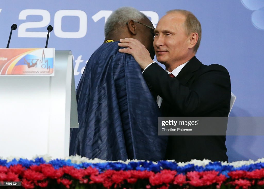 IAAF president <a gi-track='captionPersonalityLinkClicked' href=/galleries/search?phrase=Lamine+Diack&family=editorial&specificpeople=636938 ng-click='$event.stopPropagation()'>Lamine Diack</a> (L) embraces Russian President <a gi-track='captionPersonalityLinkClicked' href=/galleries/search?phrase=Vladimir+Putin&family=editorial&specificpeople=154896 ng-click='$event.stopPropagation()'>Vladimir Putin</a> looks on the opening ceremony during Day One of the 14th IAAF World Athletics Championships Moscow 2013 at Luzhniki Stadium on August 10, 2013 in Moscow, Russia.
