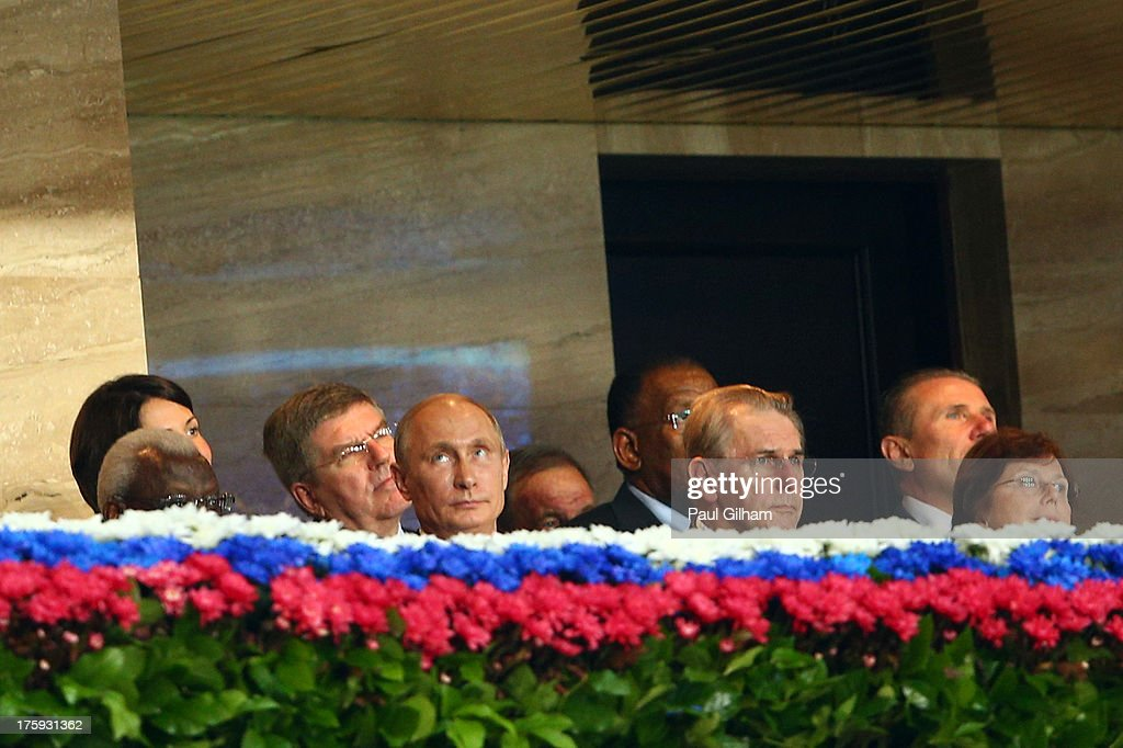 IAAF president <a gi-track='captionPersonalityLinkClicked' href=/galleries/search?phrase=Lamine+Diack&family=editorial&specificpeople=636938 ng-click='$event.stopPropagation()'>Lamine Diack</a>, Russian President <a gi-track='captionPersonalityLinkClicked' href=/galleries/search?phrase=Vladimir+Putin&family=editorial&specificpeople=154896 ng-click='$event.stopPropagation()'>Vladimir Putin</a> and President of the International Olympic Committee (IOC) <a gi-track='captionPersonalityLinkClicked' href=/galleries/search?phrase=Jacques+Rogge&family=editorial&specificpeople=206143 ng-click='$event.stopPropagation()'>Jacques Rogge</a> attend the opening ceremony during Day One of the 14th IAAF World Athletics Championships Moscow 2013 at Luzhniki Stadium on August 10, 2013 in Moscow, Russia.