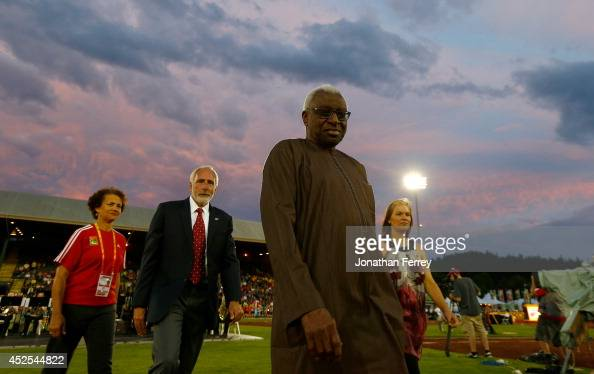 President Lamine Diack walks out itno the infield fore the opening ceremonies with Track Town USA President Vin Lanana during day one of the IAAF...