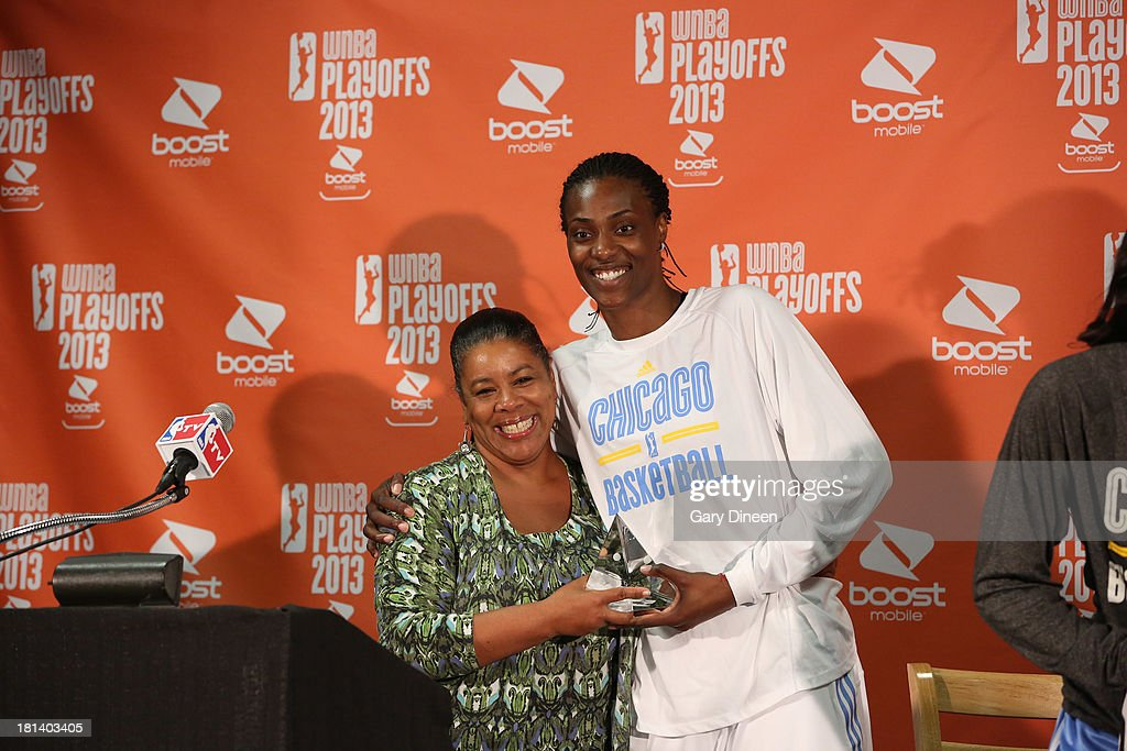 President Laurel J. Ritchie presents Sylvia Fowles #34 of the Chicago Sky the 2013 WNBA Defensive Player of the Year award during a press conference on September 20, 2013 at the Allstate Arena in Rosemont, Illinois.