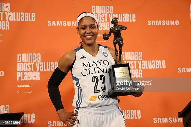 President Laurel Richie presents the 2014 WNBA Most Valuable Player Award to Maya Moore of the Minnesota Lynx during a press conference on August 21...