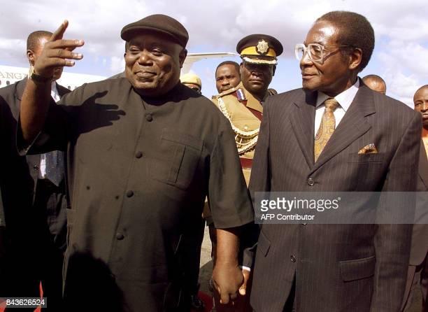 President Laurent Kabila of the Democratic Republic of Congo gestures holding hands with Zimbabwean counterpart Robert Mugabe upon Kabila`s arrival...