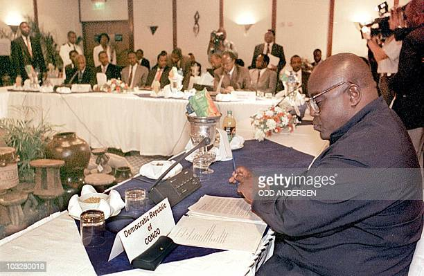 President Laurent Kabila of the Democratic Republic of Congo reads notes 07 September during a summit meeting in Victoria Falls Kabila and five other...