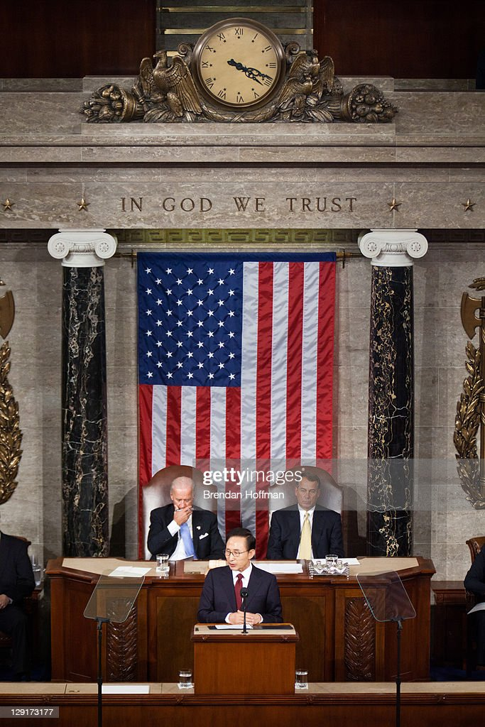 President Lee Myung-bak of South Korea (C), flanked by Vice President Joe Biden (L) and Speaker of the House Rep. <a gi-track='captionPersonalityLinkClicked' href=/galleries/search?phrase=John+Boehner&family=editorial&specificpeople=274752 ng-click='$event.stopPropagation()'>John Boehner</a> (R-OH), addresses a joint session of Congress on October 13, 2011 in Washington, DC. President Lee is on a state visit to the United States.