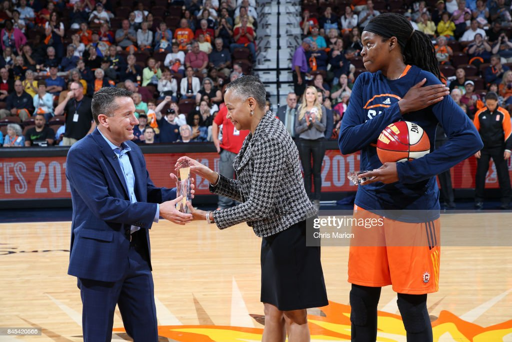 President Lisa Borders presents a trophy to Connecticut Sun General Manager Curt Miller who is named the 2017 WNBA Basketball Executive of the Year during the game against the Phoenix Mercury in Round Two of the 2017 WNBA Playoffs on September 10, 2017 at Mohegan Sun Arena in Uncasville, CT.