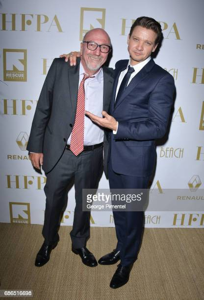 President Lorenzo Soria and Jeremy Renner attends the Hollywood Foreign Press Association's 2017 Cannes Film Festival Event in honour of the...