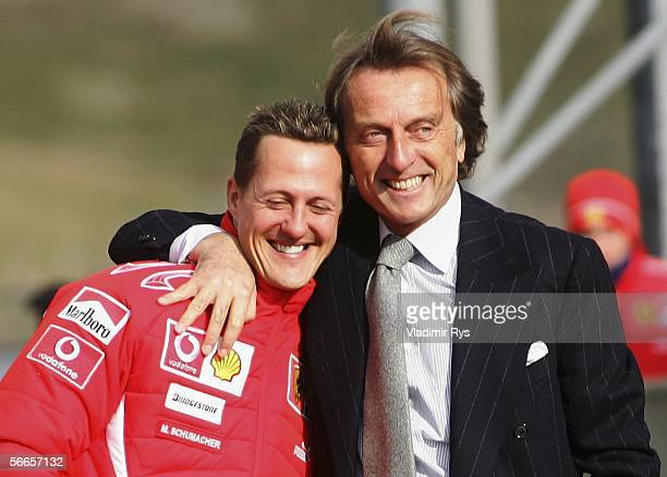 President Luca di Montezemolo of Ferrari hugs his driver Michael Schumacher of Germany during the launch of the new Ferrari F1 car for the Season...