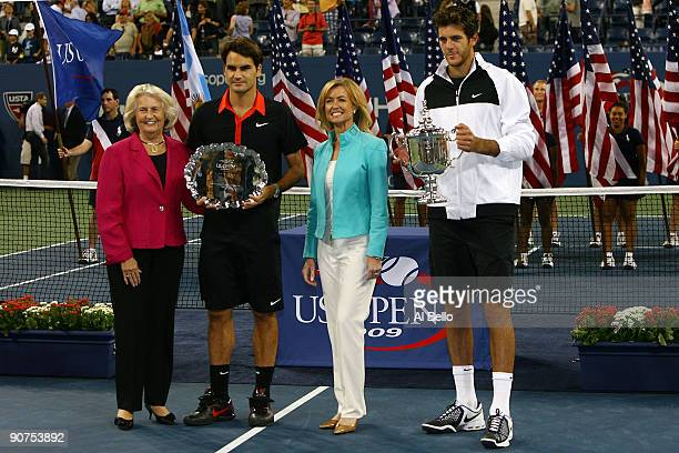 USTA president Lucy S Garvin Roger Federer of Switzerland and Juan Martin Del Potro of Argentina pose with the trophies after the Men's Singles final...