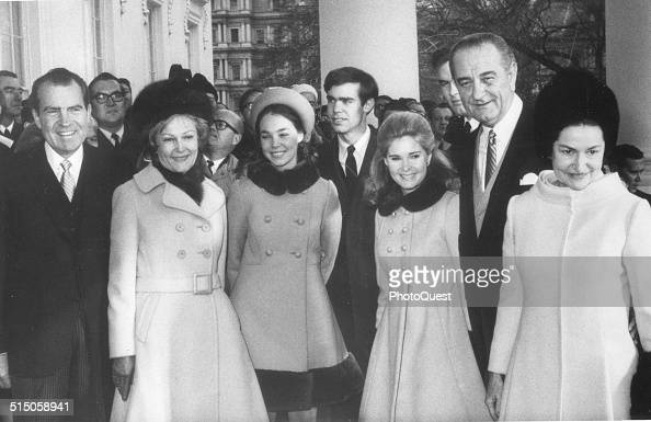 President Lyndon B Johnson and First Lady Lady Bird Johnson with PresidentElect Richard Nixon and Patricia Nixon and family before departing for...