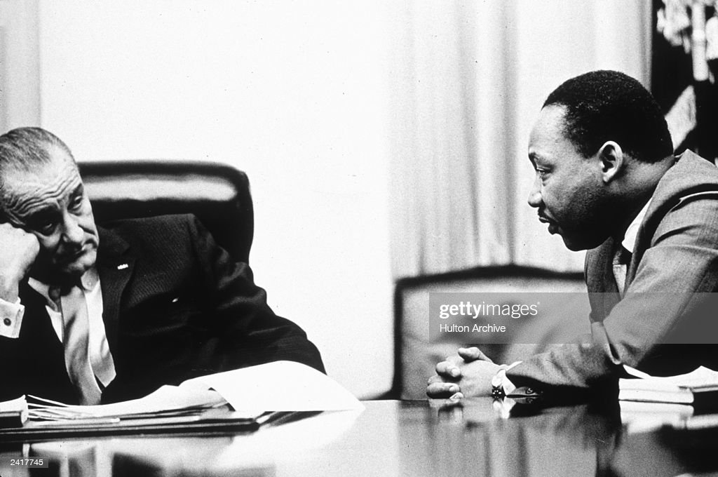 President Lyndon B Johnson (1908 - 1973) discusses the Voting Rights Act with civil rights campaigner <a gi-track='captionPersonalityLinkClicked' href=/galleries/search?phrase=Martin+Luther+King+Jr.&family=editorial&specificpeople=70030 ng-click='$event.stopPropagation()'>Martin Luther King Jr.</a> (1929 - 1968). The act, part of President Johnson's 'Great Society' program trebled the number of black voters in the south, who had previously been hindered by racially inspired laws, 1965.