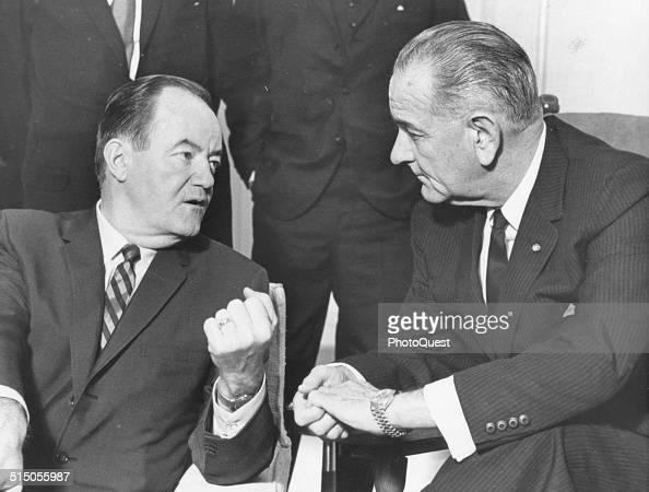 President Lyndon B Johnson listens to VicePresident Hubert H Humphrey's report of his fiveday Far East tour Washington DC January 3 1966