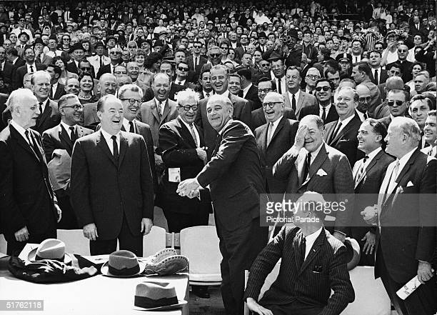 US President Lyndon Baines Johnson throws out the first pitch of the 1965 baseball season at District of Columbia Stadium Washington DC April 12 1965...
